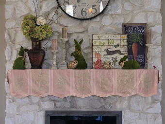 Fireplace mantel with Easter bunnies and mantel skirt.