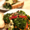 Kale and Cauliflower Salad on plate with bread and butter
