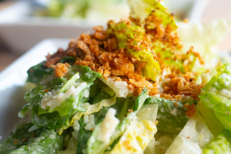 Caesar salad on plate with toasted breadcrumbs